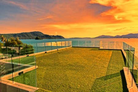 Luxurious terrace overlooking a tropical sea sunset Archivio Fotografico