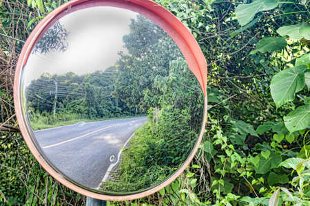 Reflection of a road panoramic mirror in tropical landscape