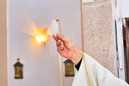 Catholic religious ceremony of Eucharist - selective focus Stock Photo
