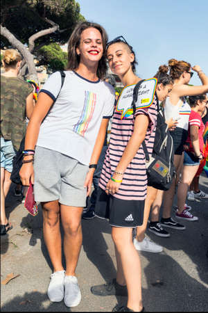 Ostia Lido Rome, Italy - July 14, 2018 :Girls participate in the Lazio Pride event and pose happy for the camera. Lazio Pride it s event for the rights, protection and pride of LGBTI people (Lesbian, Gay, Bisex, Trans and Intersex).