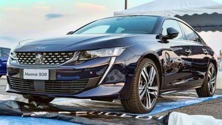 Rome, Italy - July 21, 2018: On occasion of Rome's Rally event, the motor showrooms exhibit new cars models in Rome: A new Peugeot 508 blue car from Peugeot automaker.