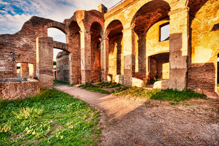 Roman ruins in Ostia Antica with glimpse of the arcades and shops in the block of Serapide - Rome