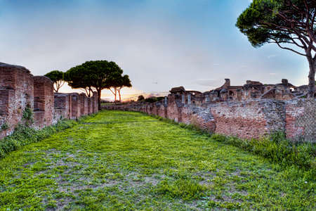 Archaeological Roman empire street view in Ostia Antica - Rome - Italy