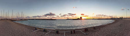 Ostia Lido Rome, Italy - January 17, 2019: Sunset at marina beach in Rome, with the view of the entrance to the port. It is the tourist port of Rome located in the coastal district of Ostia Lido.