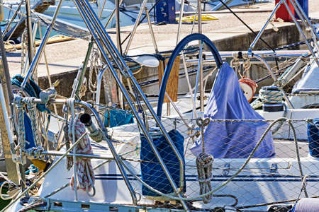 Rope winches, ropes and accessories and chromes in well equipped sailboat in white fiberglass