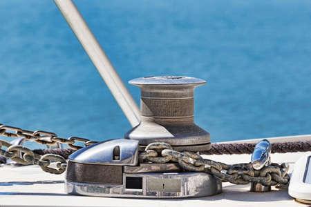 Chrome winch in a modern fiberglass sailboat 写真素材