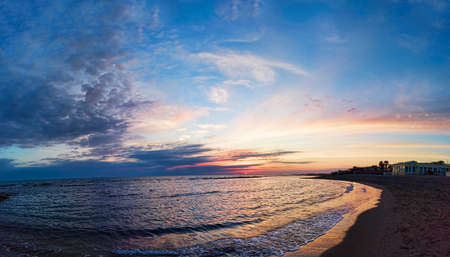 Panoramic blue sunset on Roman coast at Ostia Lido, with the intense sky the calm sea and a relaxing atmosphere 写真素材