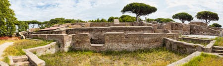 Panoramic view in 180 degrees of the Roman empire ruin and lush vegetation  at archaeological excavations in Ostia Antica - Rome Archivio Fotografico - 129623310