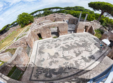 Panoramic view of the thermal baths of Neptune in the archaeological excavations of Ostia Antica with the famous mosaic depicting the Triumph of Neptune with the God of the sea above a carriage drawn by seahorses is surrounded by dolphins, Nereids and sea monsters