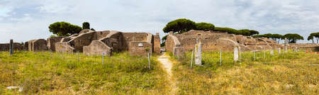 Panoramic view in 180 degrees in the Roman empire village ruins in Ostia Antica with the gym of Neptune spa at archaeological excavation - Rome Archivio Fotografico - 129623353