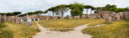 Panoramic view - 180 degree - of the Barracks of the Fire Brigade - Caserma dei vigili - located in the Roman archaeological excavations in Ostia Antica - Rome Archivio Fotografico - 129623351
