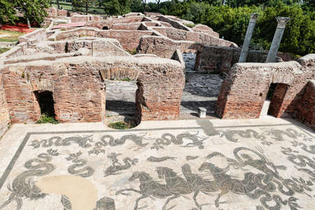 Neptune Roman empire thermal spa with frigidarium and landscape in Ostia Antica - Rome - Italy