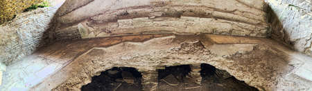 Panoramic close up view in 180 degrees inside the kilns ruin used in ancient Rome to heat water.  Ostia Antica - Rome Archivio Fotografico - 129623357