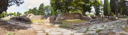 Immersive panoramic 180 degree view from cobblestone pathway of  ancient Roman necropolis landmark  in the archaeological excavations of Ostia Antica - Rome,Italy Archivio Fotografico - 129623366