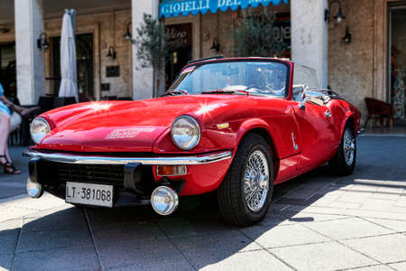 Rome, Italy - July 20, 2019: On occasion of Rome capital city Rally event, an exhibition of vintage cars has been set up with the beutiful red car model Spitfire 1300 from Triumph Motor Company automaker Editorial