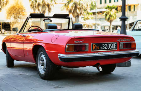 Rome,Italy - July 20, 2019:On occasion of  Rome capital city Rally event, an exhibition of vintage cars has been set up with the beutiful red car model Alfa Romeo 1300  also called Duetto manufactured by Italian Alfa Romeo since 1966