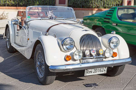Rome,Italy - July 21, 2019: On occasion of  Rome capital city Rally event, an exhibition of vintage cars has been set up with the beutiful sport white car model Morgan produced by the English car manufacturer Morgan