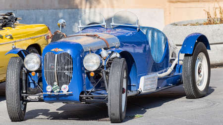 Rome,Italy - July 21, 2019:On occasion of  Rome capital city Rally event, an exhibition of vintage cars has been set up with the beutiful blue car model Morgan 44  manufactured by British  Morgan Motor Company since 1936