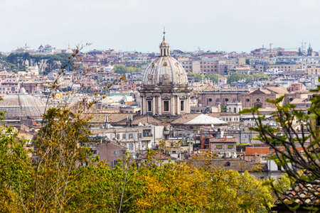 Rome's glimpse with a beautiful dome surrounded by ancient buildings and monuments, Italy Archivio Fotografico - 129623375