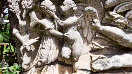 Detail of ancient Roman bas-relief carved on a sarcophagus located in archaeological excavation in Ancient Ostia, Rome Italy Archivio Fotografico - 129623380