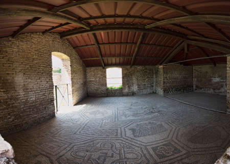 Room with the beautiful mosaics of the Dioscuri present in the Domus of Dioscuri located in the archaeological excavations of Ostia Antica in Rome Archivio Fotografico - 129623397