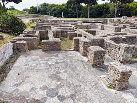 Landscape of the Apodyterium in Cisiarii thermal bath with beautiful wit mosaic flooring with geometric shapes. Located in archaeological excavation of Ostia Antica in Rome, Italy