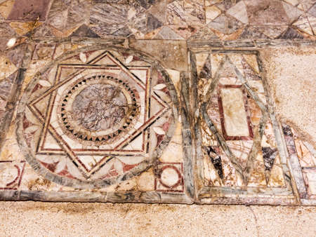 Particular of the polychrome opus sectile of the room with the three-light window in the Domus of Nymphaeum located archaeological excavations of Ostia Antica in Rome Archivio Fotografico - 129623400