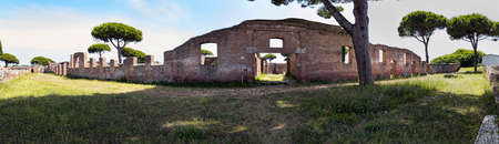 Panoramic 180 degrees outside the Garden Houses located in the archaeological excavations of Ostia Antica in Rome, Italy Archivio Fotografico - 129623399