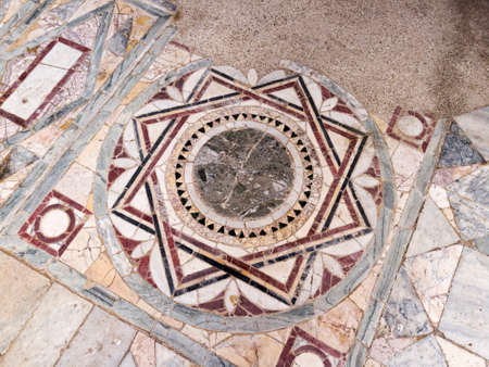 Particular of the polychrome opus sectile of the room with the three-light window in the Domus of Nymphaeum located archaeological excavations of Ostia Antica in Rome Archivio Fotografico - 129623402