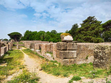 Archaeological Roman empire street view in Ancient Ostia with the pathway of republica warehouse - Rome - Italy . Фото со стока