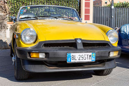 Rome,Italy - July 21, 2019: On occasion of  Rome capital city Rally event, an exhibition of vintage cars with front view of beautiful yellow cabriolet vintage car model MG MGB in yellow color