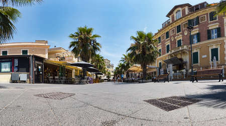 Ostia Lido Rome, Italy - July 19, 2019: Immersive panoramic street view of Anco Marzio square,with a beautiful liberty style palaces and commercial business,its located in the pedestrian area and its the center of the night life in Ostia Lido