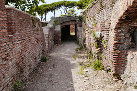 Secret paths and suggestive views in the Roman ruins at Ostia Antica, Rome Italy Archivio Fotografico - 129623413
