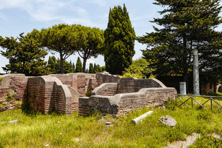 Glimpse of the ancient Roman ruins of Ostia Antica with its lush vegetation, Rome Italy Archivio Fotografico - 129623414