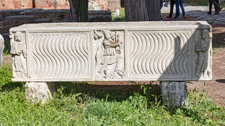 Roman sarcophagus well preserved with artistic bas-reliefs and decorations Фото со стока