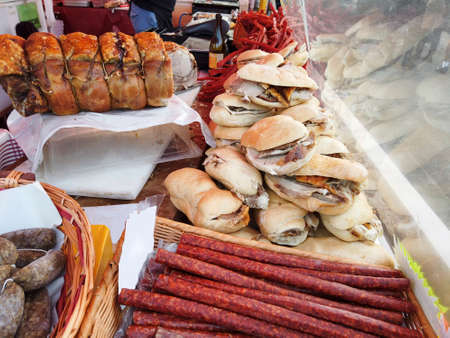 Italian flavors with the stall displaying typical products such as roast pork, sausages and sandwiches, an assorted street food