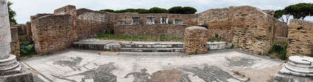Archaeological excavations of Ostia Antica immersive panoramic view in the ruin of Firefighters  Barrack with the beautiful represent mosaic of the pronaos of the shrine of the imperial cult, where the bull is led to sacrifice. Фото со стока