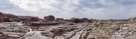 Panoramic 180 degree view of wilderness pristine with ancient geological rocks layers formation carved by wind Фото со стока
