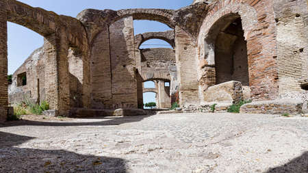 Remains of an ancient Roman tenement and frigidarium located in archeological excavation of Ostia Antica, good preserved ruins of ancient Rome, Italy