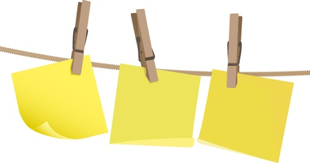 Blank yellow postit note on a wooden peg on string against a white background.