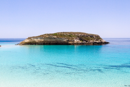 Pure crystalline water surface around an island Lampedusa