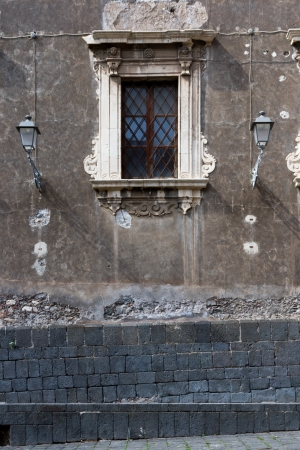 A baroque window from an ancient palace near the church in Catania, Sicily photo