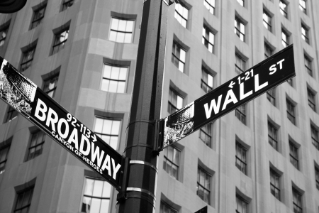 Street signs indicating the intersection of Wall Street and Broadway