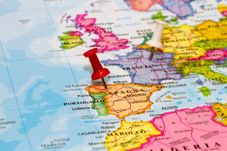 white pushpin: Map of Spain with a white pushpin stuck