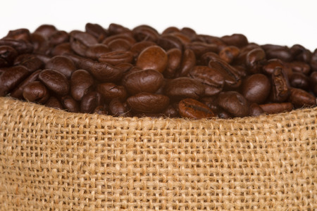 expressed: Coffee bag - coffee beans in canvas sack coffee isolated on canvas background Stock Photo
