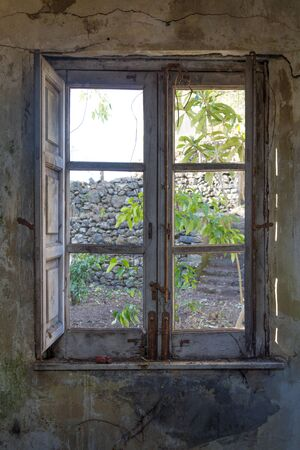 without window: old dirty window without glass on old dirty wall