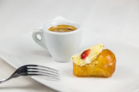 Neapolitan bab? and coffee on white white dish