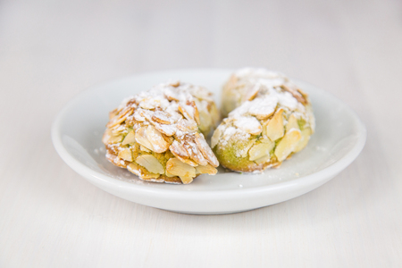 Isolated Sicilian pastry on white circular dish