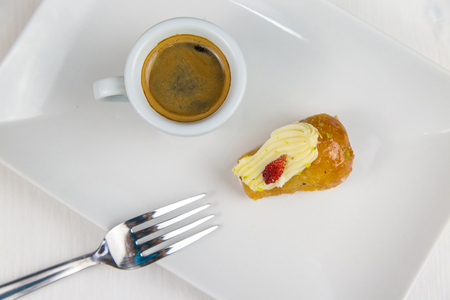 Neapolitan doll and coffee on white white dish