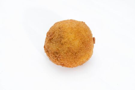 Sicilian Arancino or Arancina. A typical Sicilian street food. Made with rise, ham, meat and cheese.